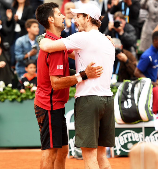 Champion Novak Djokovic and runner-up Andy Murray greet each other at the net following the French Open final on Sunday