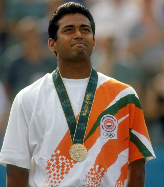 Leander Paes stands on the podium after winning the bronze medal in the men's singles tennis event at the 1996 Olympics in Atlanta on August 3, 1996. Photograph: Gary M Prior/Getty Images