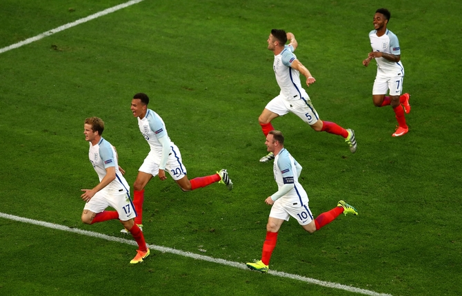 Eric Dier (left) of England celebrates with teammates after scoring a goal against Russia at Euro 2016