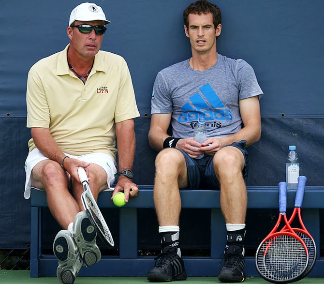 Andy Murray of Great Britain speaks with his coach Ivan Lendl