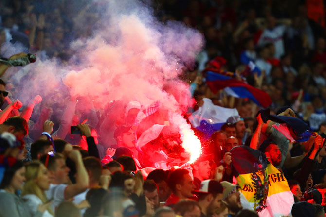 Russia supporters set off a red flare during the Euro 2016 Group B match between Russia and Slovakia at Stade Pierre-Mauroy in Lille on Wednesday