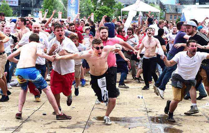 England fans celebrate at the Fanzone in Lille after Raheem Sterling netted England's late winner