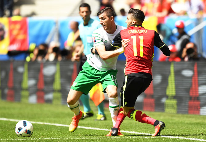 Republic of Ireland's Stephen Ward and Belgium's Yannick Carrasco compete for the ball