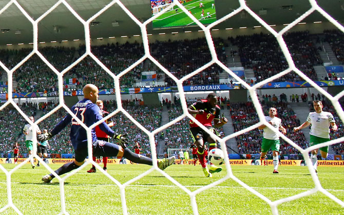 Belgium's Romelu Lukaku scores his team's third goal past Republic of Ireland's keeper Darren Randolph