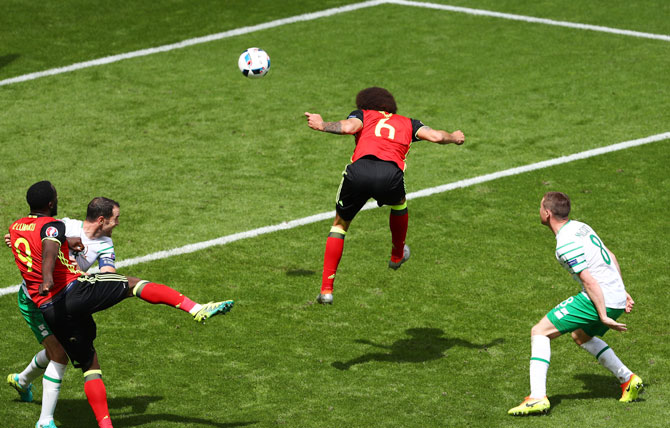 Belgium's Axel Witsel heads to score his team's second goal against Ireland