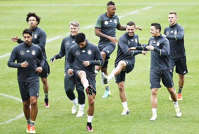 Germany's Leroy Sane, Sami Khedira, Bastian Schweinsteiger, Emre Can, Jerome Boateng, Lukas Podolski, Mesut Ozil and Joshua Kimmich during training