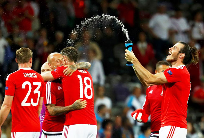 Wales captain Gareth Bale (right) and teammates celebrate victory over Russia on Monday