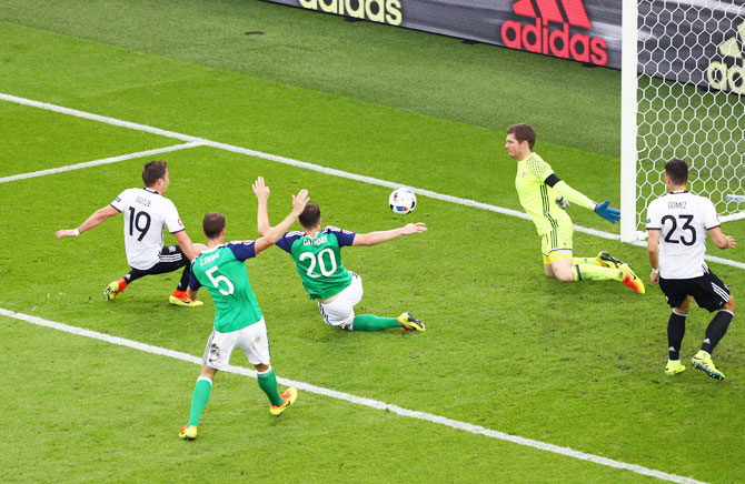 Germany's Mario Goetze (left) shoots on goal