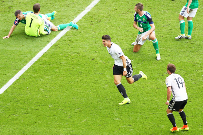 Germany's Mario Gomez (centre) celebrates scoring the opening goal against Northern Ireland during their Euro 2016 Group C match at Parc des Princes in Paris on Tuesday