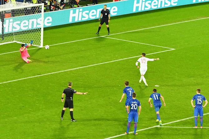 Croatia keeper Danijel Subasic saves a penalty kick by Spain captain Sergio Ramos