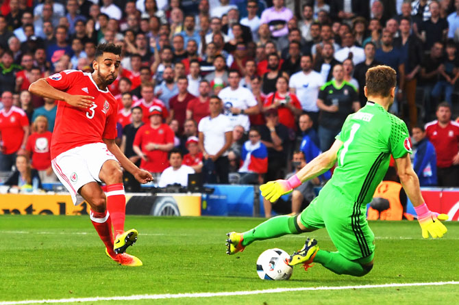 Wales' Neil Taylor scores his team's second goal past Russia keeper Igor Akinfeev