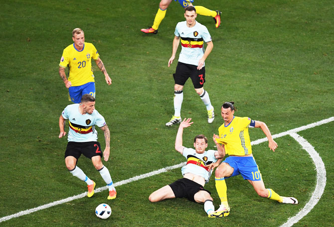Sweden's Zlatan Ibrahimovic tries to break through the Belgium defence