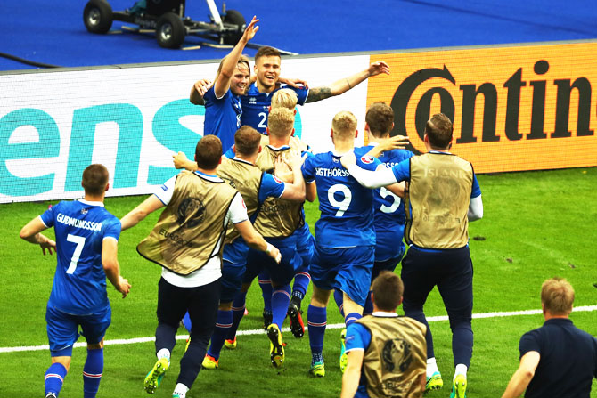 Iceland players celebrate their second goal scored by teammate Arnor Ingvi Traustason during their Euro 2016 Group F match against Austria at Stade de France in Paris, on Wednesday