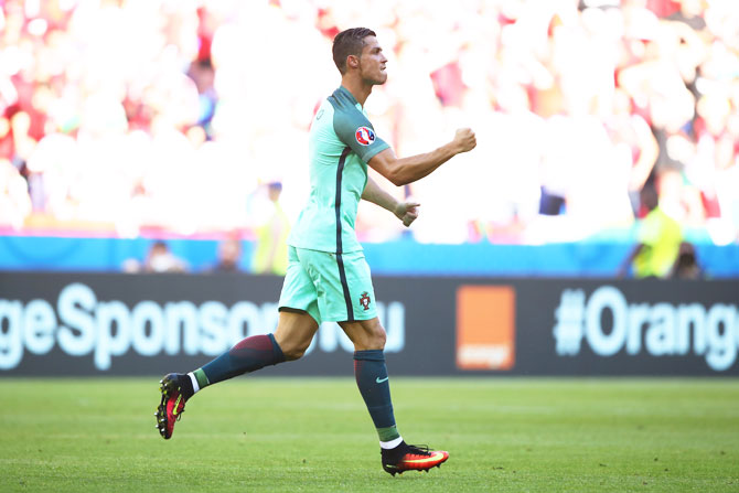 Portugal's Cristiano Ronaldo celebrates scoring his team's second goal against Hungary during their Euro 2016 Group F match at Stade des Lumieres in Lyon on Wednesday