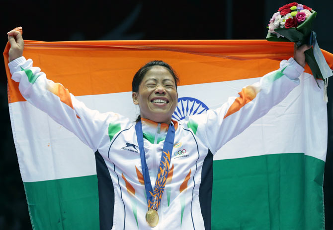 Mary Kom celebrates her gold medal at the 2014 Asian Games in Incheon, South Korea, October 1, 2014. Photograph: Chung Sung-Jun/Getty Images