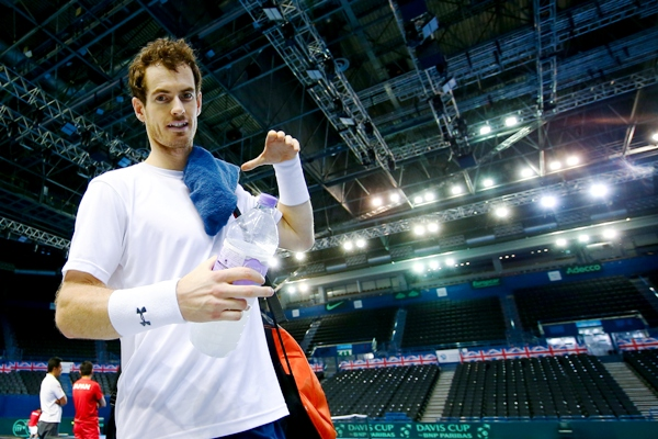 Andy Murray of Great Britain walks off court after a practice session