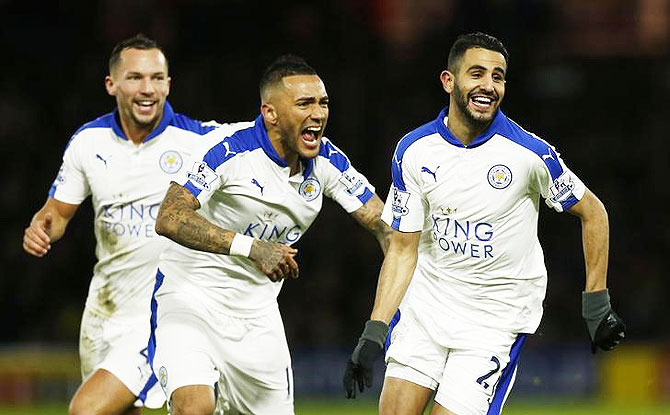Riyad Mahrez celebrates with teammates after scoring the first goal for Leicester against Watford during their English Premier League match at Vicarage Road on Saturday