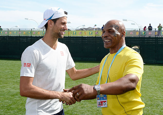 Serbia's Novak Djokovic meets Mike Tyson during day seven of the BNP Paribas Open at Indian Wells Tennis Garden in Indian Wells, California, on Sunday