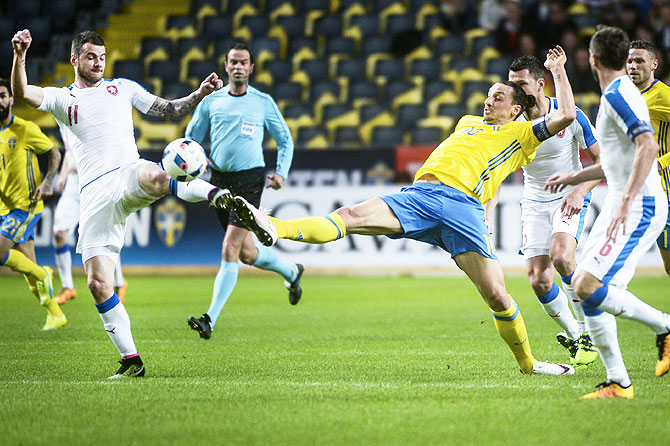 Czech Republic's Daniel Pudil (left) fights for the ball with Sweden's Zlatan Ibrahimovic during their friendly soccer match at the Friends Arena in Stockholm, Sweden