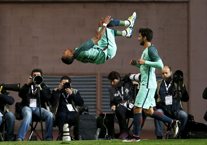 Portugal's Nani (L) celebrates his goal against Belgium