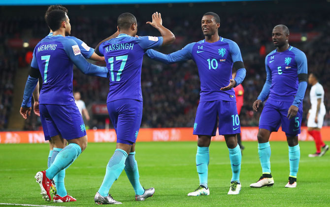 The Netherlands' Luciano Narsingh (2nd from left) celebrates scoring the winner with teammates Memphis Depay (left) and Georginio Wijnaldum during their international friendly against England at Wembley Stadium in London
