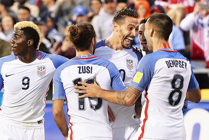 USA's Geoff Cameron celebrates his goal with teammates Graham Zusi #19 and Clint Dempsey #8 during their FIFA 2018 World Cup qualifier against Guatemala at MAPFRE Stadium in Columbus, Ohio, on Tuesday