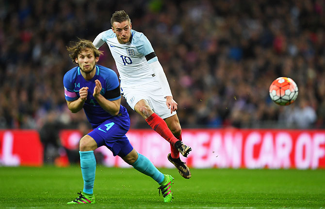 England's Jamie Vardy fires in a shot on goal past Netherlands' Daley Blind
