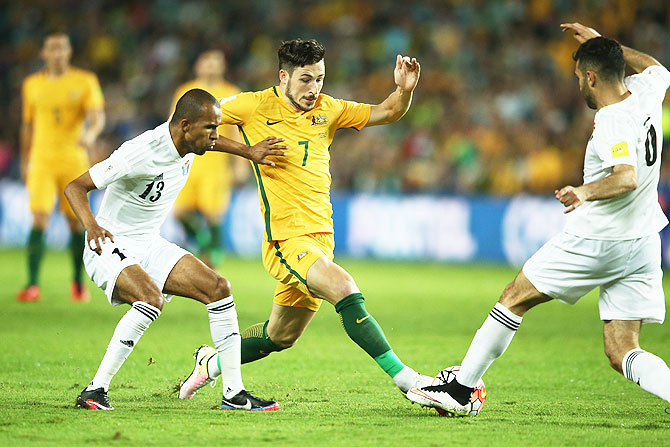 Australia's Mathew Leckie contests for the ball with Jordan's Yaseen Al-Bakhit and Ehsan Haddad during the 2018 FIFA World Cup qualifier at Allianz Stadium in Sydney on Tuesday