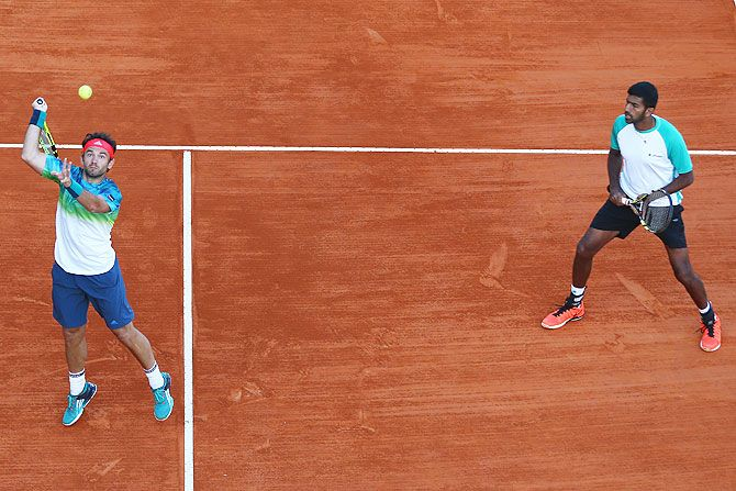 Romania's Florin Mergea and his doubles partner India's Rohan Bopanna (right) in action