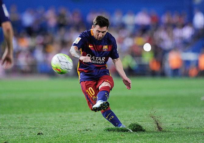Lionel Messi takes a free-kick