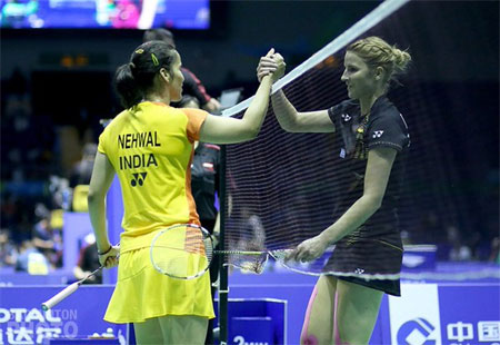 India's Saina Nehwal is congratulated by her opponent