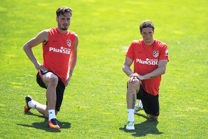 Atletico de Madrid players Saul Niguez (left) and Fernando Torres stretch during a training session in Majadahonda, Spain
