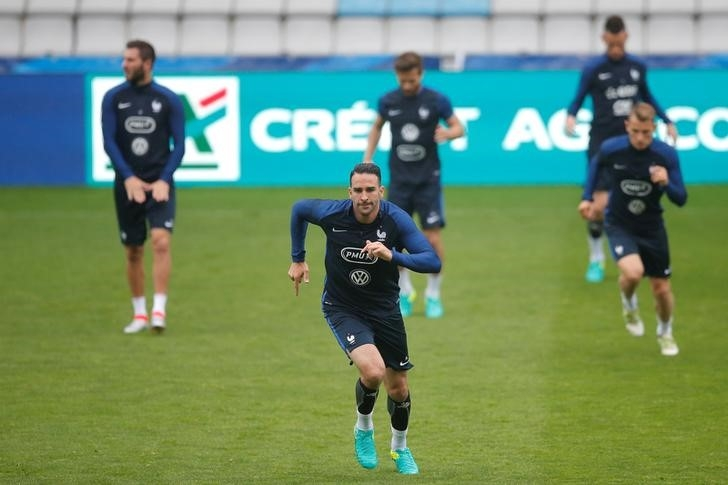 France's national soccer team player Adil Rami attends a training session