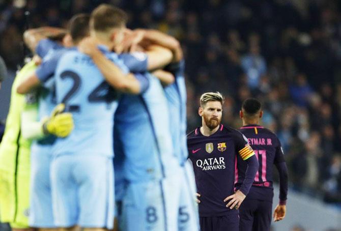 Barcelona's Lionel Messi looks dejected after the Champions League game against Manchester City at Etihad Stadium on Tuesday