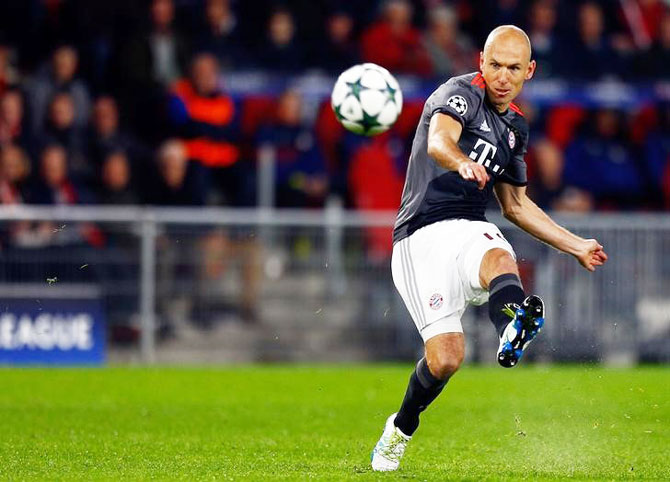 Bayern Munich's Arjen Robben takes a shot on goal