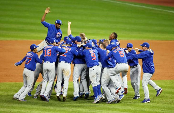 Chicago Cubs players celebrate after defeating the Cleveland Indians in game seven of the 2016 World Series at Progressive Field in Cleveland, Ohio on Wednesday