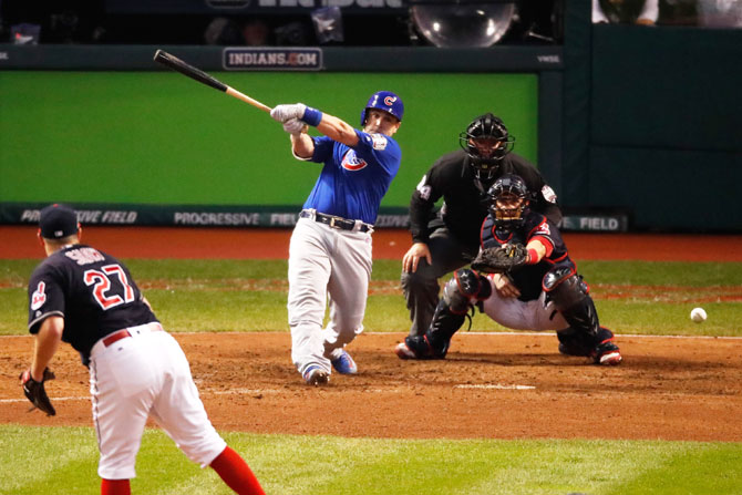 Chicago Cubs' Miguel Montero hits a RBI single in the 10th inning against the Cleveland Indians