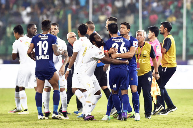 Players of Chennaiyin FC (Blue Jersy) and North East United clash during their Indian Super League (ISL) match at Jawaharlal Nehru Stadium in Chennai on Saturday