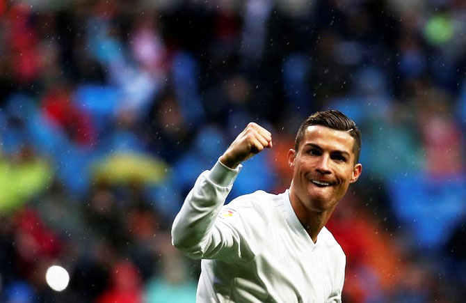 Real Madrid's Cristiano Ronaldo celebrates scoring against Sporting Gijon during their La Liga match at Santiago Bernabeu Stadium in Madrid on Saturday