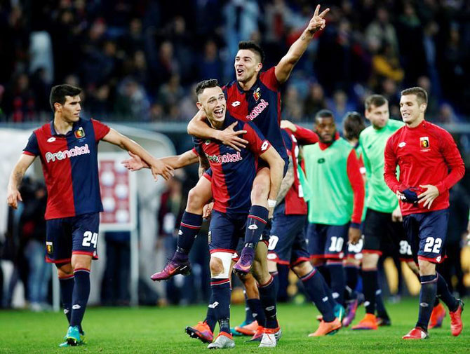 Genoa's Lucas Ocampos and Giovanni Simeone celebrate at the the end of the match after defeating Juventus on Sunday