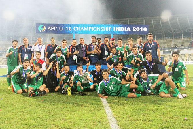 The Iraq team poses with the trophy after winning the AFC U-16 Championships in Margao Goa, on Sunday