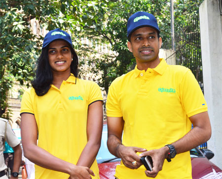 Rio Olympics silver medallist P V Sindhu with coach Pullela Gopichand at the launch of Sri Sri Ayurveda's Ojasvita range of products on Friday