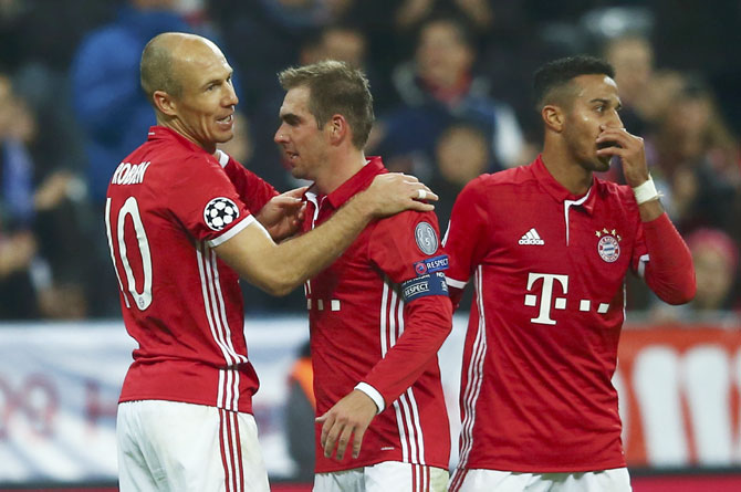 Bayern Munich's Arjen Robben celebrates his goal against PSV Eindhoven with Phillip Lahm and Thiago Alcantara at Allianz Arena, Munich, on Wednesday
