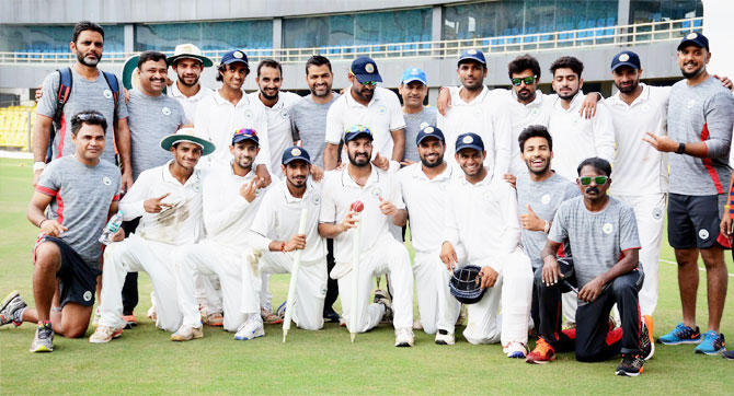 Players and officials of Haryana Cricket team posing for a photograph after defeating Chhattisgarh in the Ranji cricket match in Guwahati on Sunday