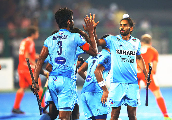 India's Rupinder Pal Singh celebrates scoring with Akashdeep Singh