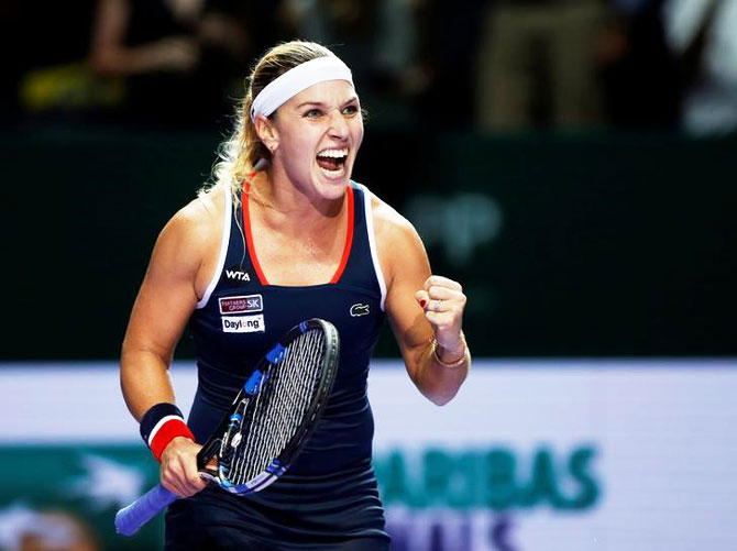 Slovakia's Dominika Cibulkova celebrates after defeating Romania's Simona Halep in their WTA Tour Finals Round Robin match at Singapore Indoor Stadium on Thursday