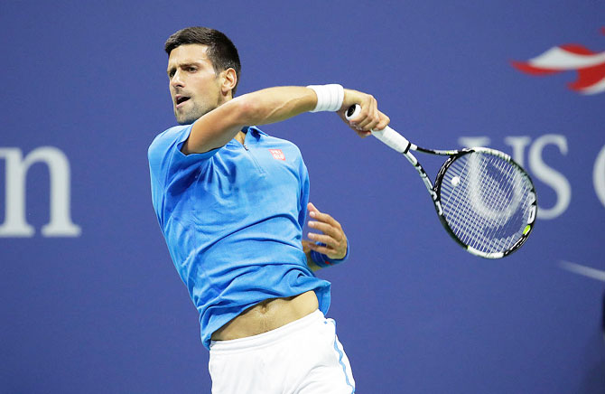 Novak Djokovic of Serbia hits a return in his match against Kyle Edmund of Great Britain during their fourth round match on Sunday