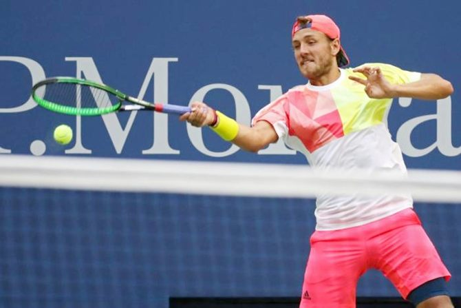 Lucas Pouille of France hits a forehand against Spain's Rafael Nadal of Spain