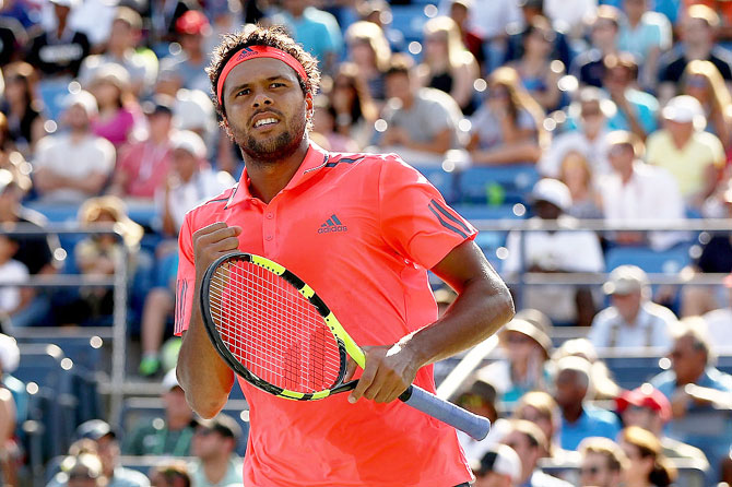 Jo-Wilfried Tsonga of France reacts against Jack Sock of the United States