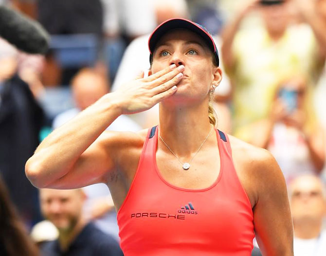 Germany's  Angelique Kerber celebrates after beating Italy's Roberta Vinci in the US Open quarters at USTA Billie Jean King National Tennis Center at Flushing Meadows on Tuesday